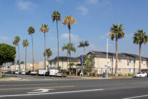 Seaport Village exterior with driveway entrance and palm trees
