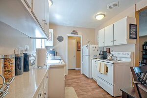 Apartments in Long Beach CA - Seaport Village Kitchen with Modern Lighting, Matching Appliances, and Lots of Storage Area